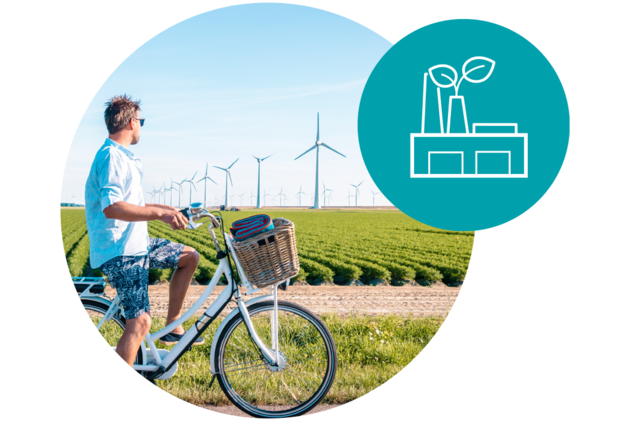 man watching windmills, using clean energy, reducing carbon footprint